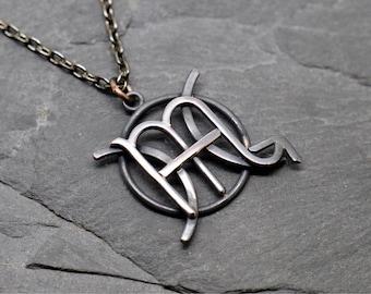 Scorpio Pisces necklace in oxidised copper