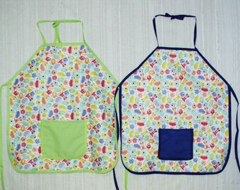 Baby & Toddlers Tie Apron Bib PUL Monsters with Blue or Green. Washable, Water resistant