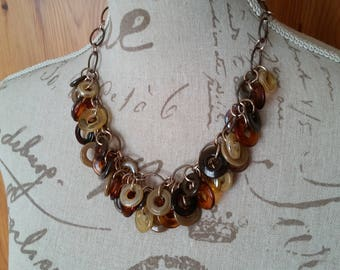 Lampwork disc necklace in antique copper with shades amber and brown glass