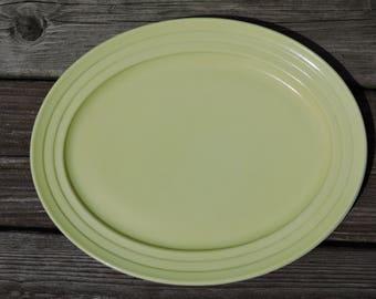 """Hazel Atlas Moderntone Platonite Oval Yellow Ribbed Serving Platter on White Milk Glass, 12"""" Platter"""