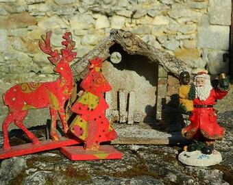 1 Christmas Crib, 1 Santa Claus, 1 Reindeer and 1 Christmas Tree