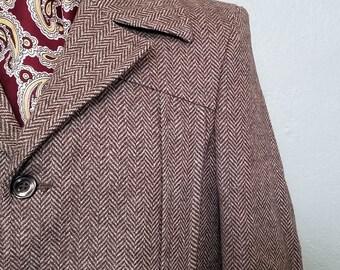 Norfolk jacket with belted back