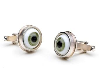 Cufflinks, 925/000 silver. Doll eyes, green.