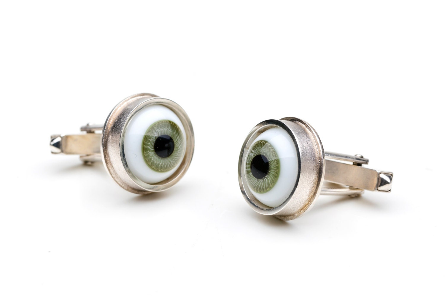 Cufflinks, 925/000 silver. Doll eyes, green.