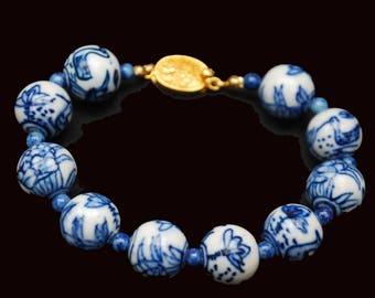 Blue White Porcelain bead bracelet - Asian - gold clasp - painted Birds flowers