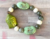 Green Buddha Beaded Stretch Bracelet with a Mixture of Fun Beads