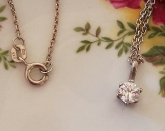 Vintage sterling silver necklace, with round solitaire cz gemstone.