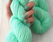 "Hand dyed ""Hint of Mint"" superwash merino sock yarn"