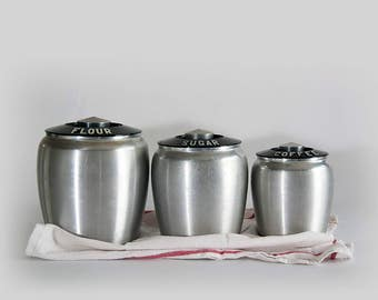 Vintage Kromex Set of Three (3) Aluminum Canister Flour Sugar Coffee Containers with Black Lids