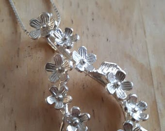 Sterling silver Forget me not garland pendant on a silver chain