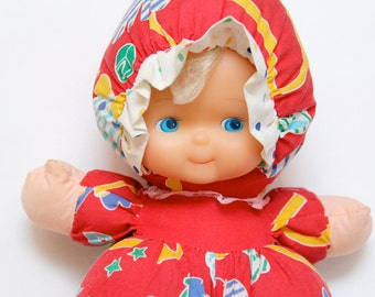 Vintage fabric doll with rubber head and squeaky tummy