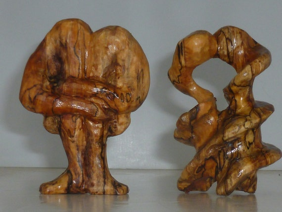 Lovers embrace hand carved abstract wood sculpture of