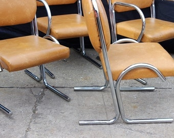 Midcentury tubular chrome dining chairs, by Douglas Furniture of California