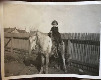 Vintage photo Little girl on s pony