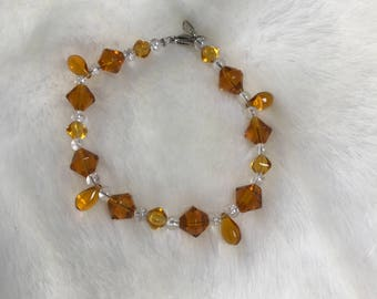 """7"""" amber and clear glass bead bracelet"""