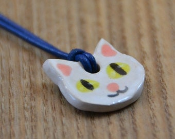 White Cat Ceramic Medaillon on a Leather Necklace