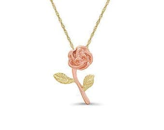 "14k solid gold two tone rose pendant on an 18"" chain."