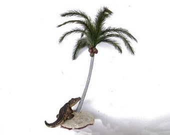Coconut Palm Tree 7 inches tall loaded with coconuts planted in a sand covered base