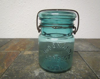"""Antique blue green """"McDONALD PERFECT Seal Jar""""  with Glass cover and Bail : pint jar, 10 on jar bottom , canning jar *  * #M-1"""