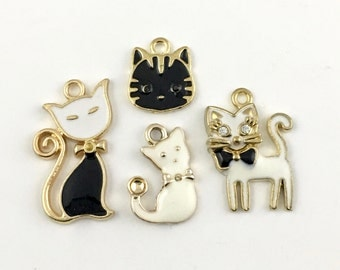 4 cat gold and enamel charms, 15mm to 29mm # CH 354