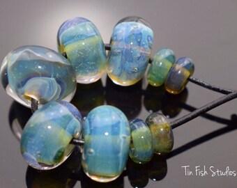 Blue Multi Colored Encased Glass 9 Bead Set