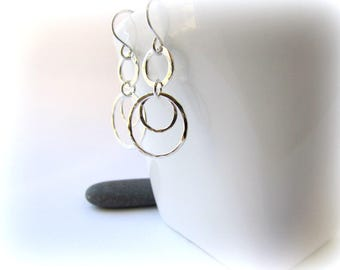 Silver dangle earrings. Sterling silver earrings. Hammered earrings. Handmade Maine Jewelry. Circle earrings. Silver hoop earrings.