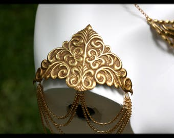 Filigree Repousse epaulettes with chains.