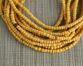 2-3mm Marigold Yellow Coconut Shell Pucalet Rondelle Beads Dyed and Waxed 15 inch strand
