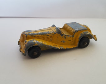 Vintage Tootsietoy  chippy yellow paint Classic MG toy car, 1960's medium size 3 1/8""