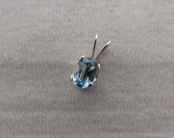 Swiss Blue Topaz .55 ct  6x4 mm Oval Sterling Silver Necklace Pendant
