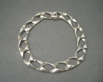 Elegant structural sterling silver bracelet.