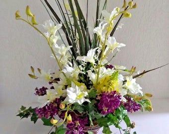 Large White orchid and deep purple lilacs arrangement