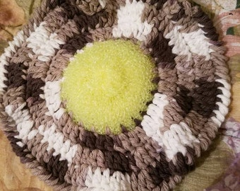 Yellow scrubbie with brown  dishcloth