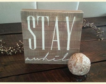 "Sign - ""STAY awhile"""