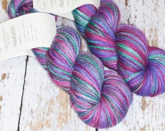 Hand Dyed KM Fingering Sock Yarn Superwash Merino Wool Nylon in green, burgandy, and purple