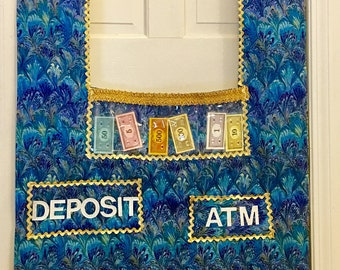 Doorway play bank with laminated money and matching apron