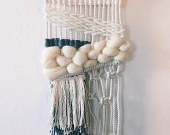 small woven macrame wall hanging with naturally dyed indigo accent