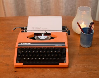 Portable typewriter orange SILVER-REED SILVERETTE S