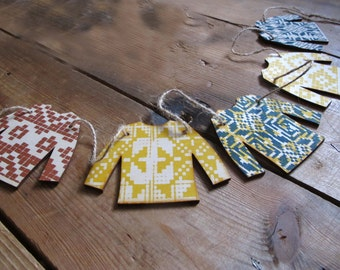 Christmas jumper garland, made from laser cut screen printed ply wood.