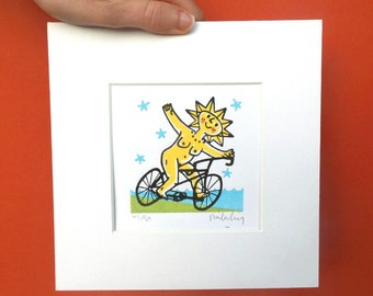 Limited edition handmade relief print, signed by Mike Levy small 'Brigid on a Bike' sun, face,smile