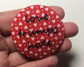 Love Trumps Hate - hand embroidered pinback button, red hearts