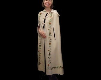 "Swedish hand embroidered white wool cape, shoulder to hem is 54"". (model is 5'10"")"