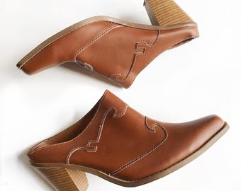 Light brown leather western clogs with stacked heels. Size 9.