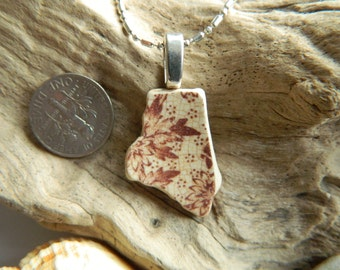 Sea pottery shard necklace with leafy details in autumn brown