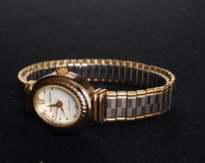 Storewide 25% Off SALE Vintage Ladies Textured Two Tone Gold & Silver Sergio Valente Designer Quartz Watch Featuring Flexible Designer Band