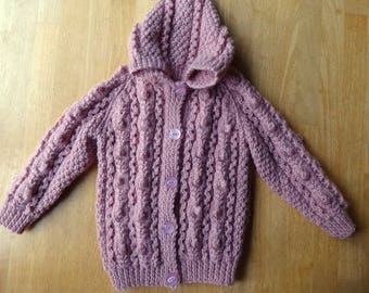 Hand Knitted childs wool jacket 25 ins Chest 3 + yrs. PINK cable with Hoodie & 5 buttons.