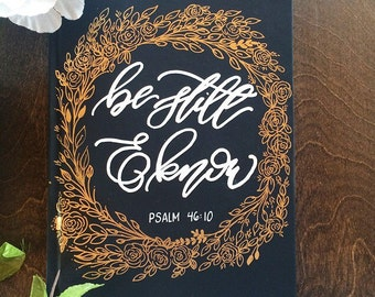 "Hardcover ""Psalm 46:10"" black, gold, and white notebook"