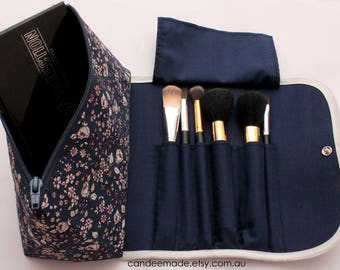 Large navy Floral Makeup Bag with a Brush Holder Flap and Snap Button.