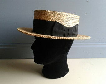 French vintage straw boater / summer hat with black satin ribbon, circa 1930s.