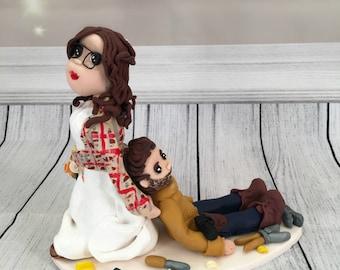 Wedding cake Topper Bride Dragging Groom - Fully Personalised a lovely keepsake